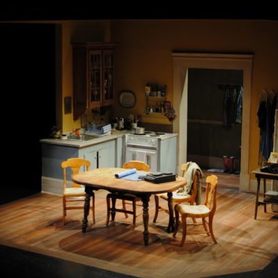 Set sans-actors with a better view of the cabinet in background. The sink upstage had running water used throughout the show.