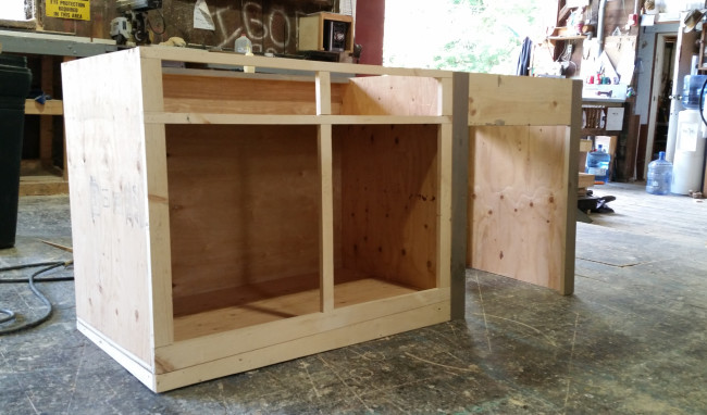 Process shot of the counter I constructed. The counter was built with a compound angle counter-rake, so that the top of the counter would be truly level while sitting lopsided on a raked stage.