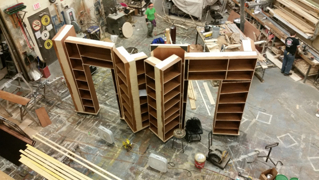 Rolling Bookcases. Book cases were 18' tall and rolled off stage for changeover into Midsummer.